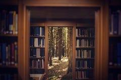 Samengesteld beeld van dichte omhooggaand van een 3d boekenrek Stock Foto
