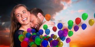 Samengesteld beeld van dichte omhooggaand van gelukkig jong paar Royalty-vrije Stock Foto's