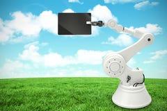 Samengesteld beeld van digitaal beeld die van robot digitale tablet 3d houden Stock Foto
