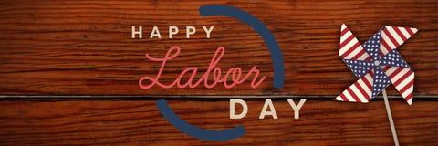 Samengesteld beeld van digitaal samengesteld beeld van de gelukkige teksten van de arbeidsdag met blauw overzicht Stock Foto's