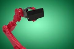 Samengesteld beeld van digitaal geproduceerd beeld die van rode robot slimme telefoon 3d houden Stock Afbeelding