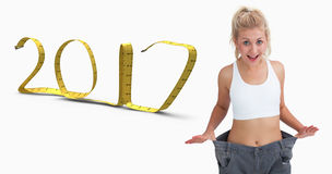 Samengesteld beeld van dunne vrouw die oude broek na het verliezen van gewicht dragen Royalty-vrije Stock Fotografie