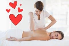 Samengesteld beeld van een massagezitting met liefdeharten vector illustratie