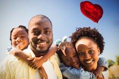 Samengesteld beeld van familie en rode 3d hartballon Stock Afbeeldingen