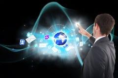 Samengesteld beeld van geconcentreerde zakenman status en 3d richten Stock Afbeeldingen