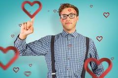 Samengesteld beeld van geeky die hipster in kussen wordt behandeld Stock Fotografie