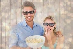 Samengesteld beeld van gelukkig jong paar die 3d glazen dragen die popcorn eten Stock Afbeelding