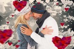 Samengesteld beeld van gelukkig paar in de wintermanier het omhelzen Royalty-vrije Stock Afbeeldingen