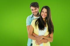 Samengesteld beeld van gelukkig toevallig paar die bij camera glimlachen royalty-vrije stock afbeelding