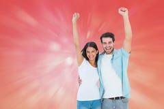 Samengesteld beeld van gelukkig toevallig paar die samen toejuichen Royalty-vrije Stock Fotografie