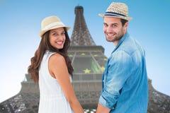 Samengesteld beeld van gelukkige de holding van het hipsterpaar handen en het glimlachen bij camera Stock Foto's