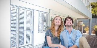 Samengesteld beeld van gelukkige paarzitting op de vloer royalty-vrije stock afbeelding