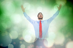 Samengesteld beeld van gelukkige toejuichende zakenman die zijn wapens opheffen Royalty-vrije Stock Foto's