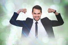 Samengesteld beeld van gelukkige zakenman in kostuum het toejuichen Stock Foto