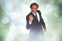 Samengesteld beeld van gelukkige zakenman met vuist Stock Foto