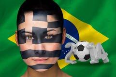 Samengesteld beeld van Griekse voetbalventilator in gezichtsverf Stock Foto