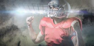 Samengesteld beeld van het Amerikaanse voetbalster toejuichen met dichtgeklemde vuist Stock Fotografie