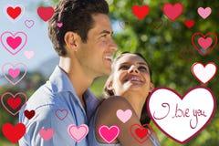 Samengesteld beeld van het houden van en gelukkig jong paar bij park Royalty-vrije Stock Afbeelding