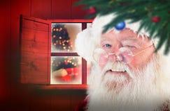 Samengesteld beeld van het knipogen van de Kerstman Royalty-vrije Stock Afbeelding