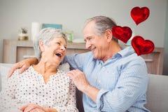 Samengesteld beeld van hogere paar en liefde 3d hartballons Royalty-vrije Stock Afbeelding