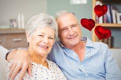 Samengesteld beeld van hogere paar en valentijnskaarten 3d harten Stock Afbeelding