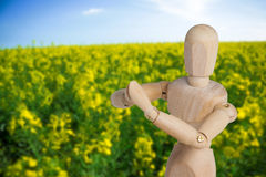 Samengesteld beeld van houten 3d beeldje die yoga uitvoeren Royalty-vrije Stock Foto's