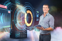 Samengesteld beeld van knappe zakenman die digitale tablet over witte 3d achtergrond gebruiken Royalty-vrije Stock Foto's