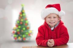 Samengesteld beeld van leuke jongen in santahoed Stock Foto's