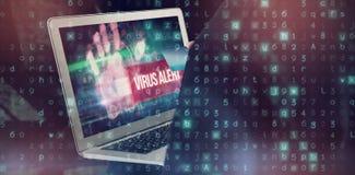 Samengesteld beeld van medio sectie van hakker die creditcard en laptop met behulp van Royalty-vrije Stock Afbeelding