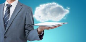 Samengesteld beeld van midsection van 3d de tabletcomputer van de zakenmanholding Stock Foto's