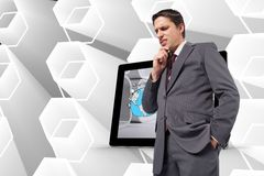 Samengesteld beeld van nadenkende zakenman met hand op kin Stock Foto