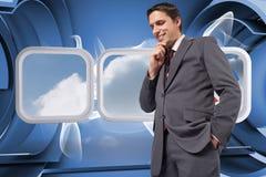 Samengesteld beeld van nadenkende zakenman met hand op kin Stock Afbeelding