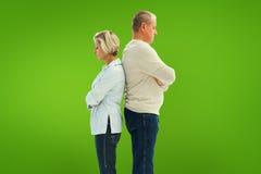 Samengesteld beeld van ongelukkig paar die aan elkaar spreken niet stock foto's
