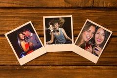 Samengesteld beeld van onmiddellijke foto's op houten vloer stock fotografie