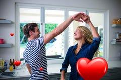 Samengesteld beeld van paar en 3d valentijnskaartenharten die dansen Stock Afbeelding
