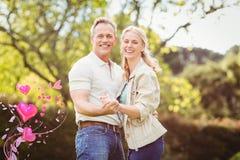 Samengesteld beeld van paar en valentijnskaarten 3d harten Stock Afbeeldingen