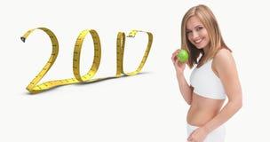 Samengesteld beeld van portret van gelukkige jonge vrouw die groene appel houden Royalty-vrije Stock Afbeelding