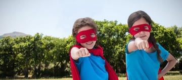 Samengesteld beeld van portret van leuke siblings met rood GLB en masker Royalty-vrije Stock Fotografie