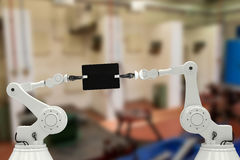 Samengesteld beeld van robots en digitale tablet tegen witte 3d achtergrond Stock Foto's
