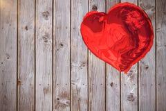 Samengesteld beeld van rode 3d hartballon Stock Afbeeldingen