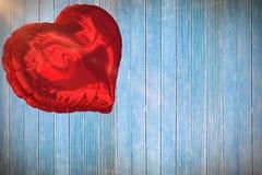 Samengesteld beeld van rode 3d hartballon Stock Foto