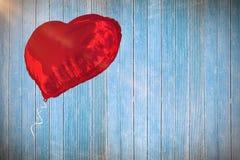 Samengesteld beeld van rode 3d hartballon Stock Fotografie