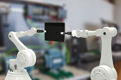 Samengesteld beeld van samengesteld beeld van robots met 3d computertablet Stock Fotografie