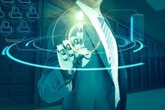 Samengesteld beeld van samenstelling van zakenman met robotachtige 3d hand Royalty-vrije Stock Afbeeldingen