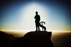 Samengesteld beeld van silhouet naast dollarsymbool stock foto