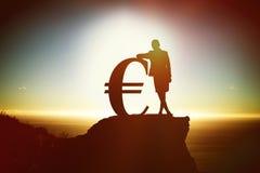 Samengesteld beeld van silhouet naast euro symbool stock afbeeldingen