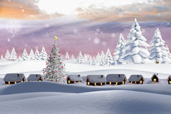 Samengesteld beeld van sneeuw behandeld dorp Stock Fotografie