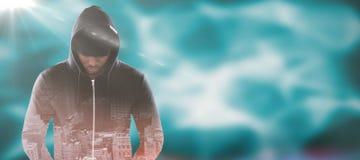 Samengesteld beeld van spion in zwarte hoodie Stock Foto's