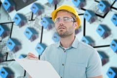 Samengesteld beeld van supervisor het kijken weg terwijl het schrijven op klembord Stock Fotografie