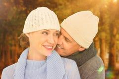 Samengesteld beeld van toevallig paar in warme kleding Stock Afbeeldingen